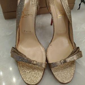 Worn once, glitter gold Louboutin heels!